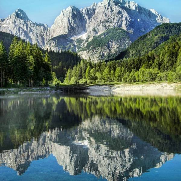 Nature really is the greatest artist.  This beautiful view comes from Lake Jasna in Kranjska Gora. Do you know the statue of which animal stands there?  Thank you @mitjarobic for sharing your photo of #jezerojasna with us.  What is your way of experiencing Slovenia? Show us by tagging your posts with #ifeelsLOVEnia and #myway.       #slovenia #kranjskagora #lakejasna #beautifuldestinations #beautifulview #beautifulnature #lake #naturephotography #natgeoyourshot #landscapes #landscapelover #topeuropephoto #europe_vacations #passionpassport #lovefortravel #loves_europe #travellingthroughtheworld #travelawesome #ig_europa #ig_landscape #worldplaces #wonderful_places #slowenien #slovenia #discoverearth