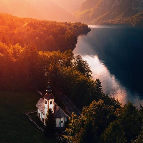 October in all its glory  • Lake Bohinj • Bohinj is the largest Slovenian natural lake, nested at the foot of unspoilt mountains and mountain tops.    #ifeelsLOVEnia #mojaslovenija #sloveniaoutdoor   Photo by @marionstoffels.