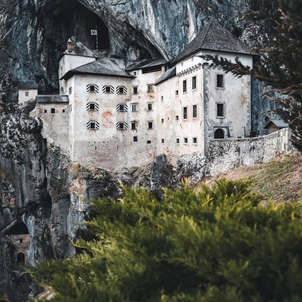 Did you know that Predjama Castle is the largest cave castle in the world?  ⁠ The impregnable medieval marvel has been perched in the middle of a 123-metre-high cliff for more than 800 years. There is even a network of secret tunnels behind it! ⁠ ⁠#ifeelsLOVEnia #myway #itsculturetime⁠ ⁠ Find out more about Predjama and other castles in Slovenia at the link in bio! You just might find some ideas for your next adventure. ⁠ ⁠ Photo by @moodywanderer. ⁠ ⁠ ⁠ ⁠ ⁠ ⁠