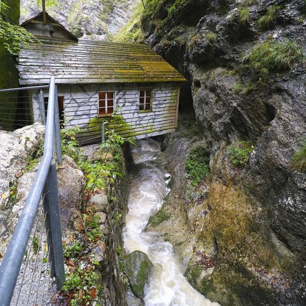 A unique cultural monument in Pasice Gorge attesting to the incredible self-sacrifice and humanity of the medical staff and other staff in their care for the wounded. More in the BIO link.   The Franja Partisan Hospital  #ifeelsLOVEnia #mojaslovenija #sloveniaculture  Photo by @visitcerkno.