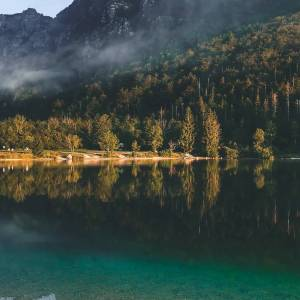 Have you ever visited this charming place, embraced by the Julian Alps?   Lake Bohinj lies in the heart of the Triglav National Park, one of the oldest national parks in Europe, is the largest Slovenian natural lake, nestled at the foot of unspoilt mountains and mountain tops. #ifeelsLOVEnia #mojaslovenija #sloveniaoutdoor  Photo by @laaaliie. 