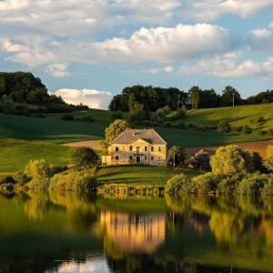 A lake is the landscape's most beautiful and expressive feature.  Lake Pernica  #ifeelsLOVEnia #mojaslovenija  Photo by @peteandcompany.