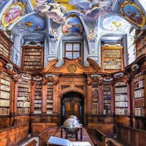 Impressive interior of Seminary Library in Ljubljana. #ifeelsLOVEnia #mojaslovenija #visitljubljana #WTD2020   The library in the Seminary Palace is the hidden pearl of the Baroque Ljubljana. You enter through the impressive entrance portal, made in 1714 in the Luka Mislej's workshop, supported by the statues of Hercules, which are the work of the sculptor Angelo Putti.  Photo by @butnomatter.theroadislife. 