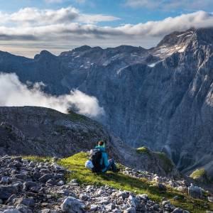 What is the secret of the success of Slovenian athletes? ▶️Find more in the BIO.  Hiker looking towards Triglav north face  #ifeelsLOVEnia #mojaslovenija #sloveniaoutdoor #teamslovenia   Photo by @jostgantar | www.slovenia.info