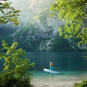 Paddling into water paradise   Lake Bohinj is the perfect spot to rest your mind and embrace your soul with nature adventures. ️ . Thanks @hollymori for sharing your photo with #ifeelsLOVEnia.
