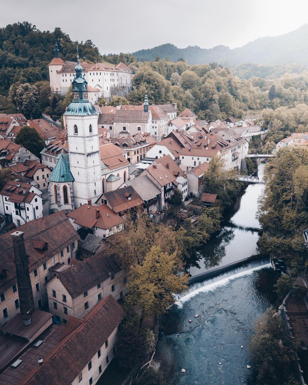 Hey this is @lukas_pousset with my favorite angle of Škofja Loka. This little town just west of Ljubljana was one of my favorite locations along the road!  w/ @ibdansch & @manuela_palmberger  #ifeelslovenia #makenewmemories • • • • • • • #skofjaloka#igslovenia #slovenia_ig #sloveniawithlove #slovenia360 #thisisslovenia #visitslovenia #slovenia #topsloveniaphoto #suspensionbridge #tourism #beautifuldestinations #woowvisuals #artofvisuals #traveleurope #travel #backpack #roadtrip #destinationideas #skofja #town
