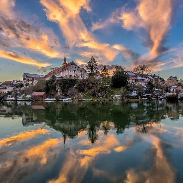 Krka river reflecting magic in the sky above the town of Novo mesto.  Thanks @sjoko_photography for sharing your photo with #ifeelsLOVEnia.
