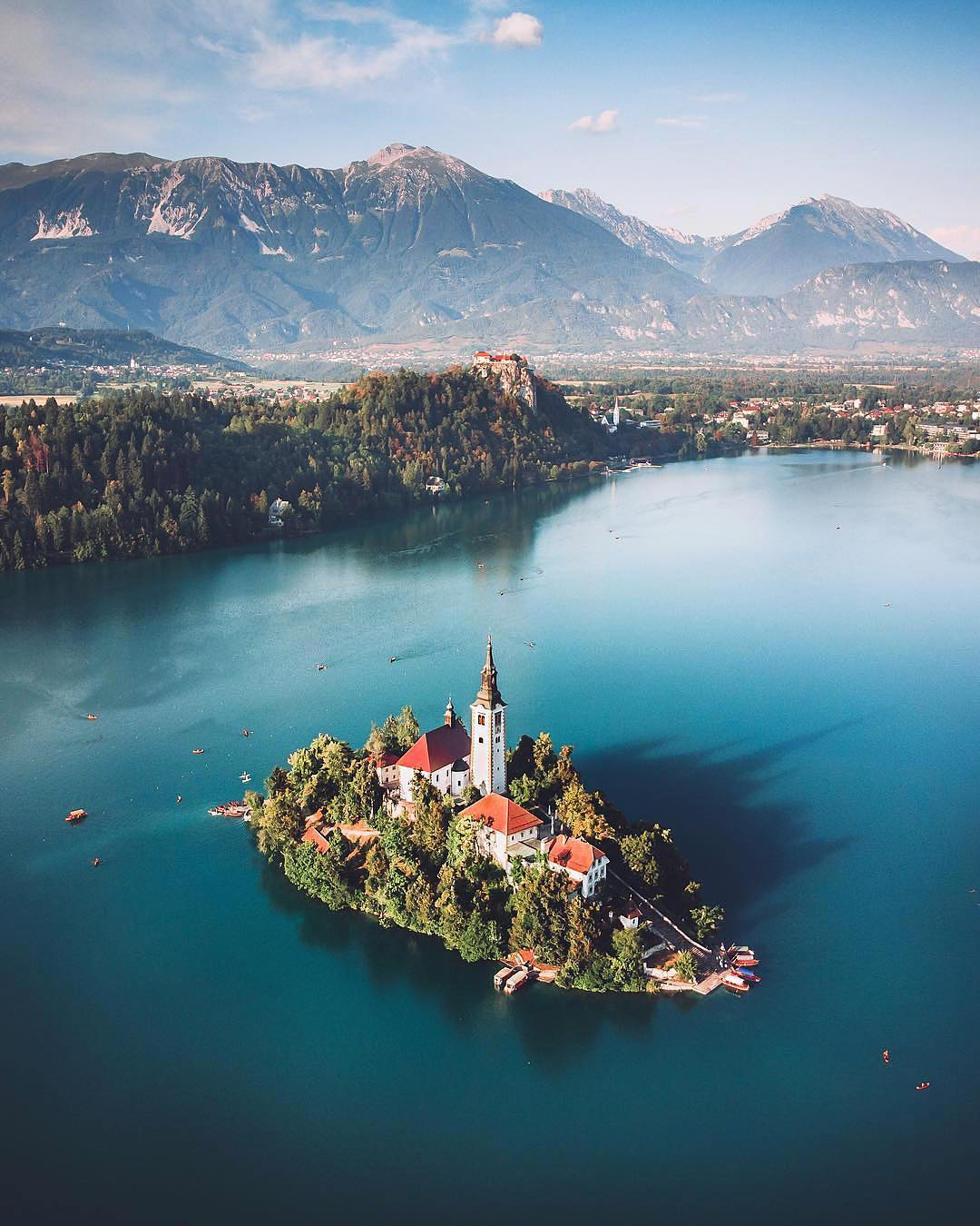 THE SYMBOL OF SLOVENIA'S  BEAUTY. This beautiful Alpine lake with the only island in Slovenia has been a world - known paradise.  Impressing visitors with its natural charm, wealth of legend, and special powers to restore well-being.  Relax your mind, calm your spirit and renew your travel experiences at this beautiful spot. Thanks @maxlazzi for sharing your photo with #ifeelsLOVEnia.