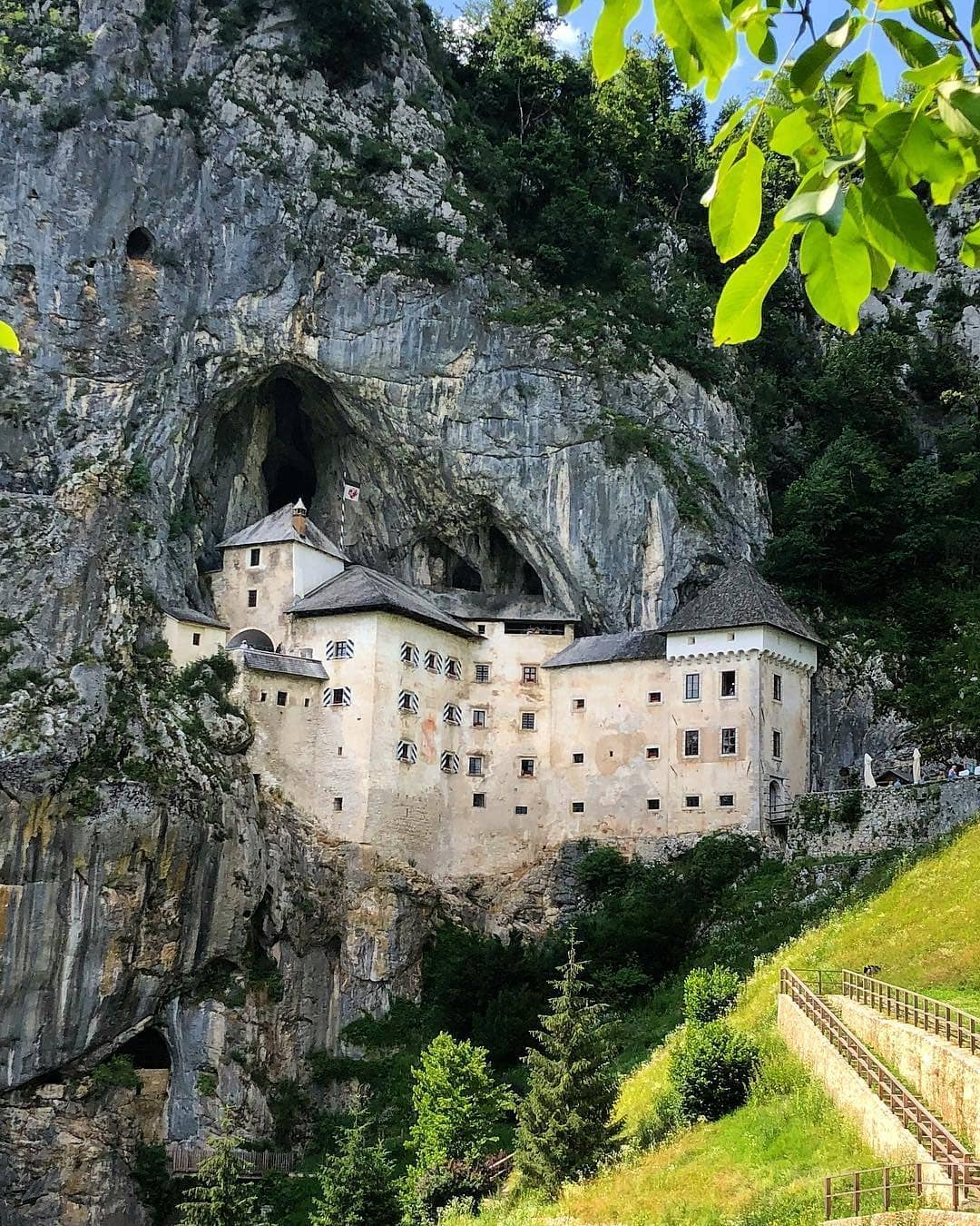 Predjama Castle is a unique castle - it's bulit up a 123m cliff and cave below it is a part of 14 km Predjama cave system.  Thanks @gourmetgadabouts for sharing your photo with #ifeelsLOVEnia.