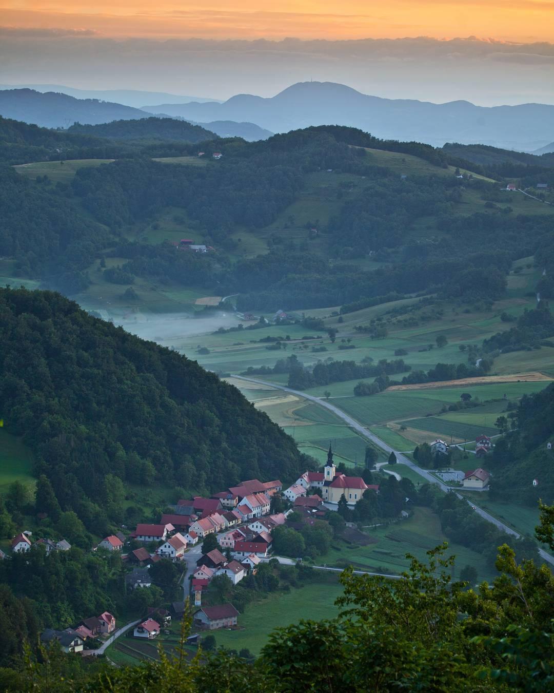 Podsreda village surrounded by Kozjansko hills in early morning.   #ifeelsLOVEnia Photo by @jostgantar