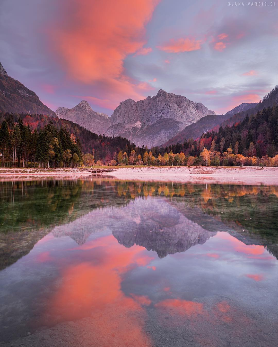 LAKE JASNA   Look at these majestic colours, pure nature.  Reflections of mountains in the crystal clear lake water.  Before the first road bends to Vršič, stop for a short break at the Jasna Lake. It consists of two interconnected artificial lakes at the confluence of the Velika Pišnica and Mala Pišnica streams. Thanks @jaka_ivancic for sharing your photo with #ifeelsLOVEnia.