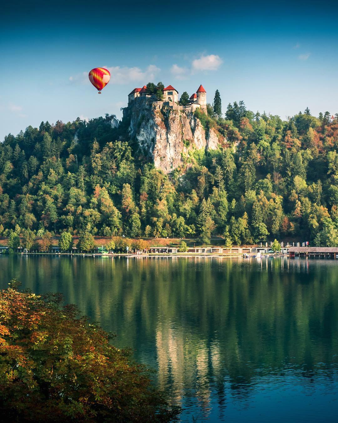 Enchanting, mesmerising, historical.  . Reflections of Bled Castle - according to written sources, the oldest castle in Slovenia.  Perched atop a steep cliff, rising 130 metres above the glacial Lake Bled.  Who would you take with you to this magical place?  Thanks @maxlazzi for this beautiful capture of yours.