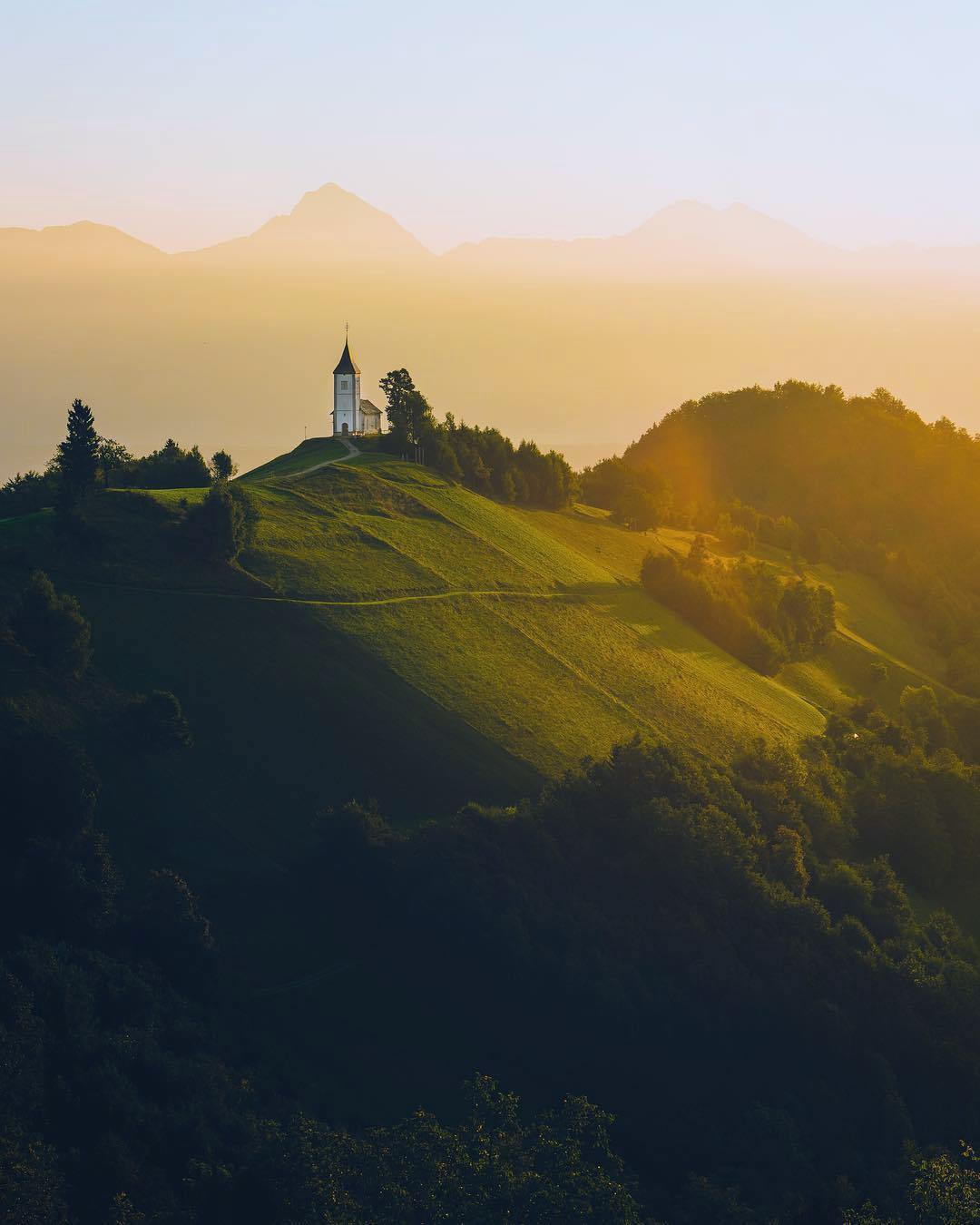 Getting up early and catching a mesmerising sunrise at a spot like this? .  Here's a hint. ️ This is Jamnik - Church of St. Primus and Felician, one of the most beautiful churches in Slovenia.  . Thanks @georgeduluth for sharing your photo with #ifeelsLOVEnia.