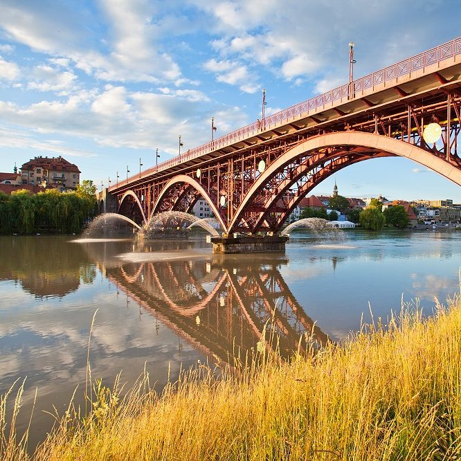 Do you know the city where this great bridge stands over Drava river?