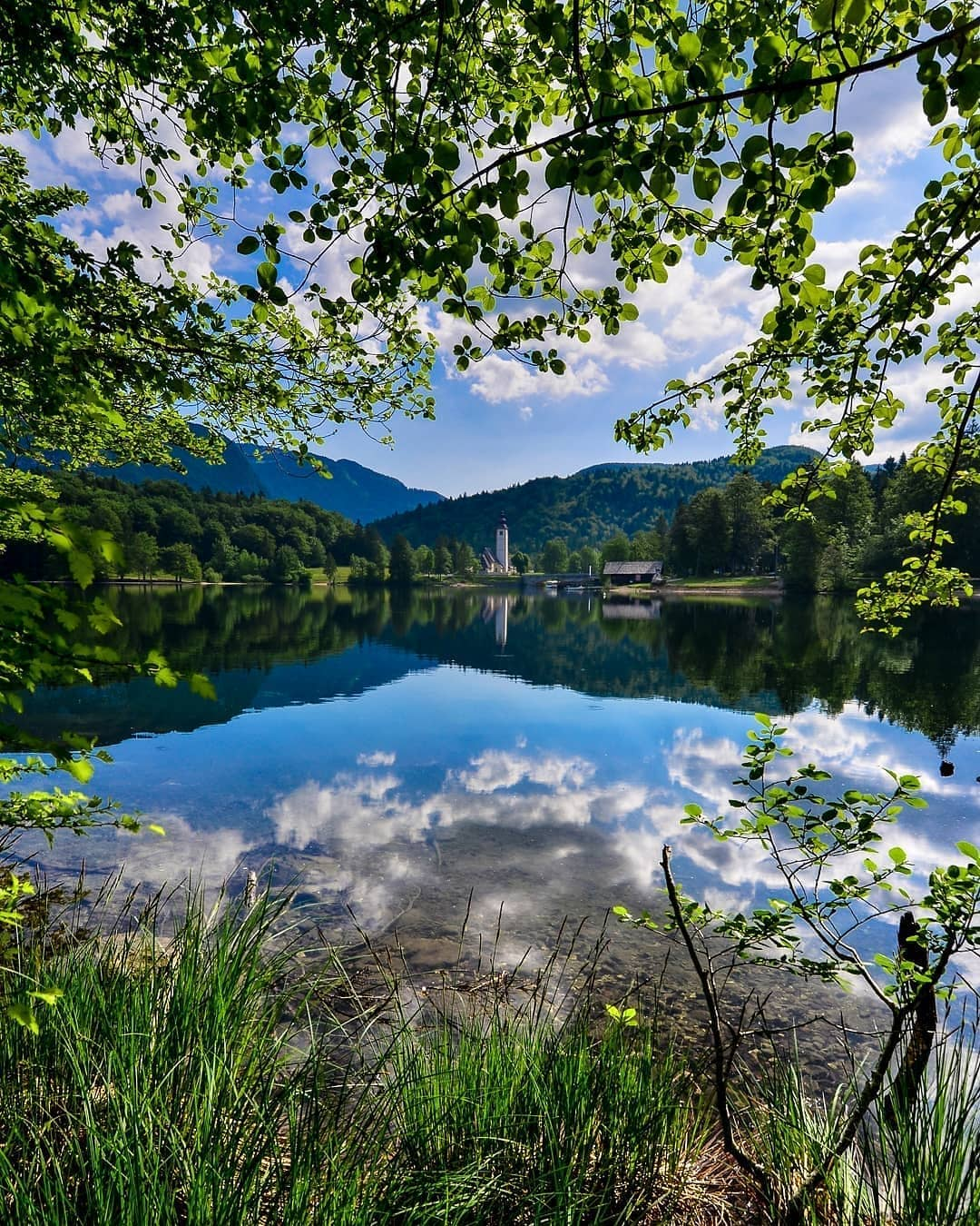 Embraced by lush geeen nature, lake Bohinj is one of the most attractive destinations in Slovenia.  Thanks @gregorskobernephotography for sharing your photo with #ifeelsLOVEnia.
